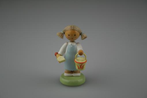 Flade Mädchen mit Sandspielzeug