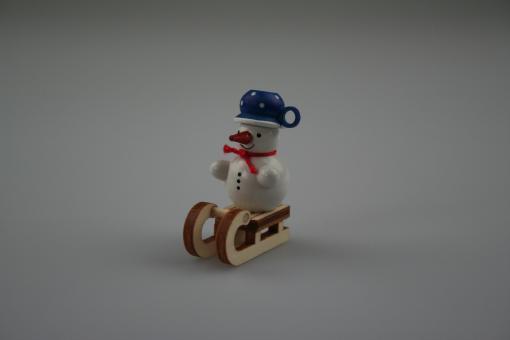 Miniatur Schneemann auf Schlitten